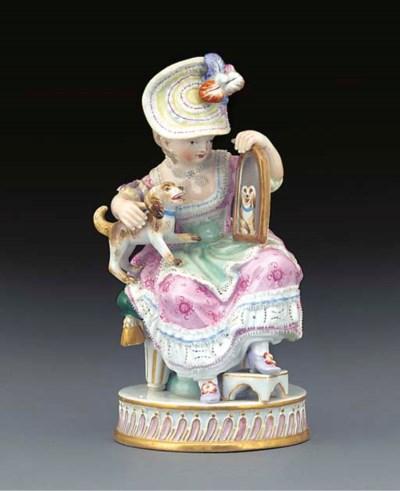 A Meissen figure of a girl wit
