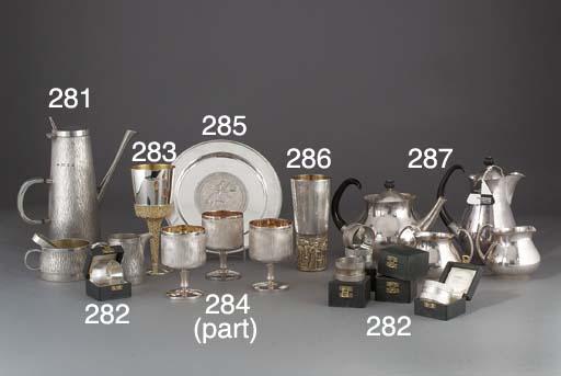 A Modern Four Piece Silver-Pla