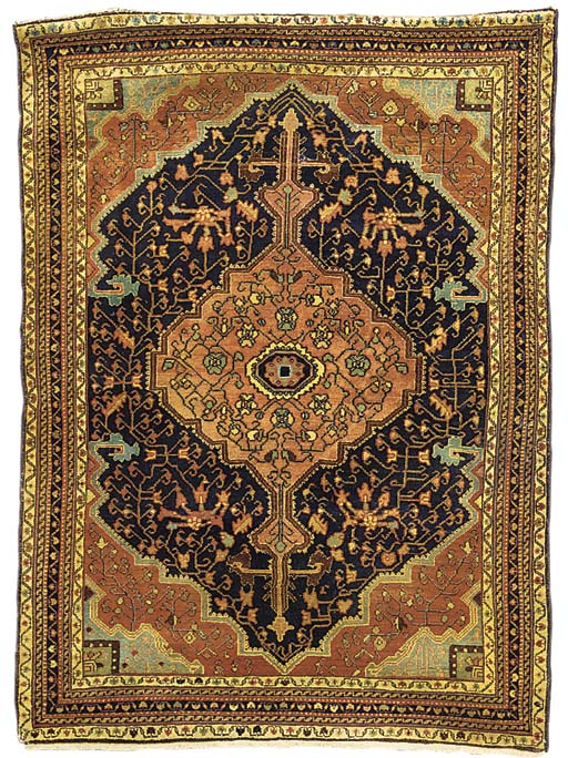 An antique Feraghan carpet, We