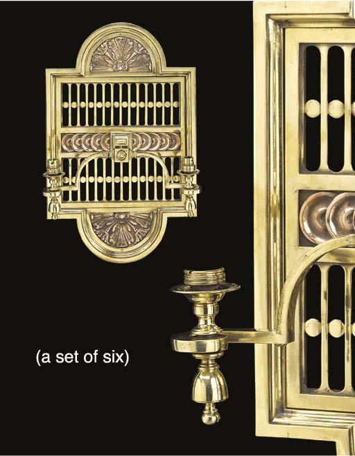 A set of six twin branch brass