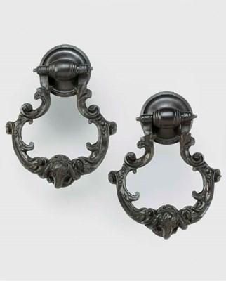 A pair of bronze door knockers