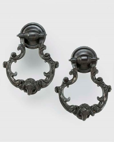 A pair of bronze door knockers