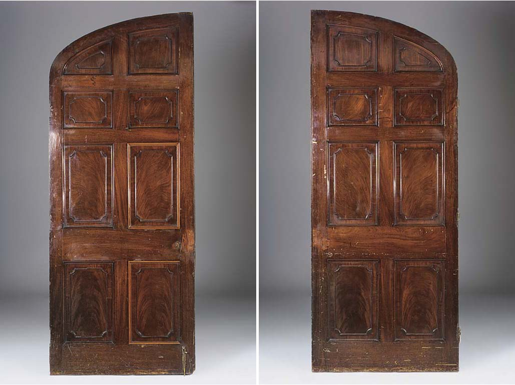 A PAIR OF MAHOGANY ARCHED PANE