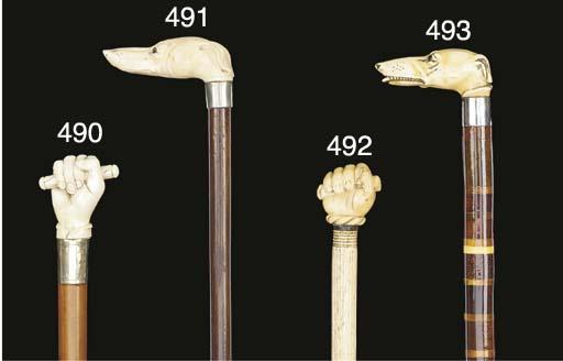 An ivory handled walking stick