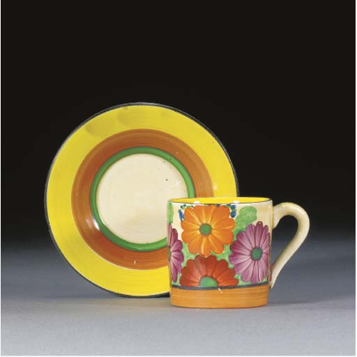 A GAYDAY COFFEE CAN AND SAUCER