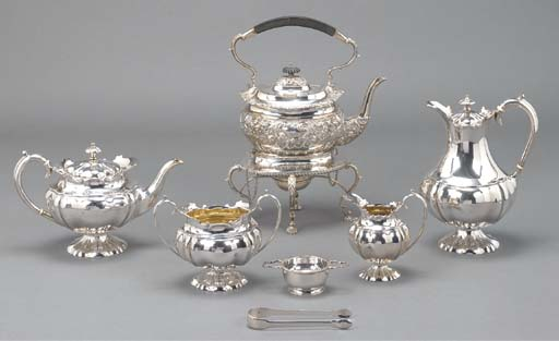 A FOUR-PIECE SILVER TEA AND CO