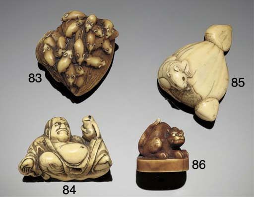 An ivory netsuke of a reclinin
