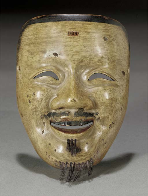 A Japanese carved wood mask of