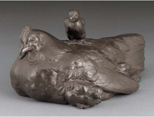 A bronze group of a hen and ch