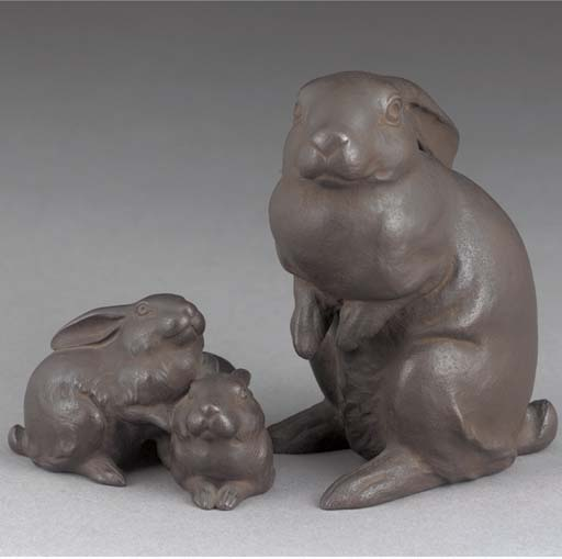 Two bronze models of a rabbit