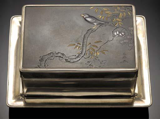 A silver rectangular box, cove