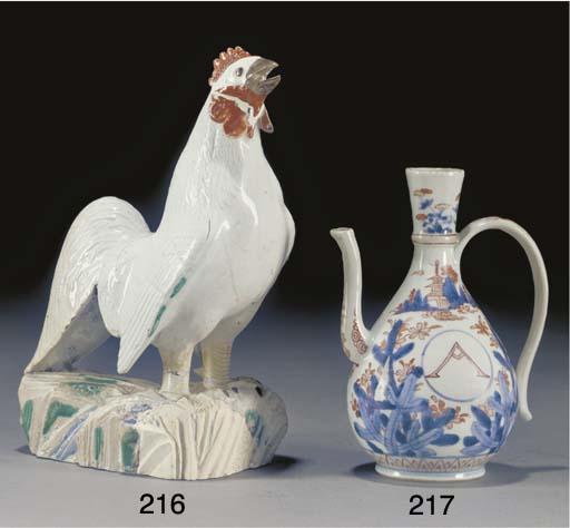 An Arita white glazed cockerel