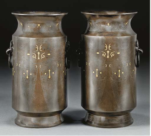 A pair of cylindrical bronze v