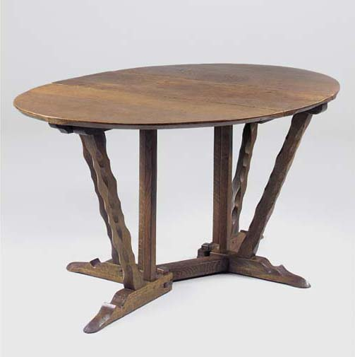 AN OAK DROP-LEAF DINING TABLE