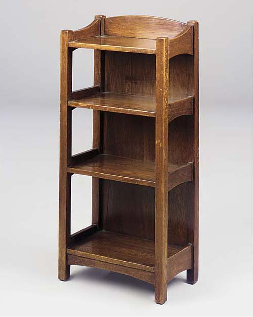 AN OAK OPEN BOOKCASE