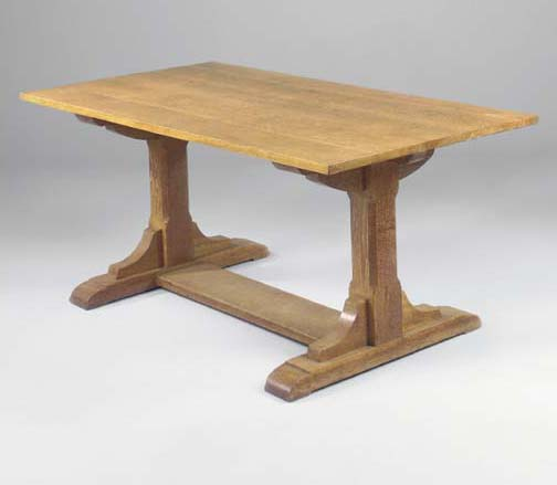 AN OAK DINING TABLE