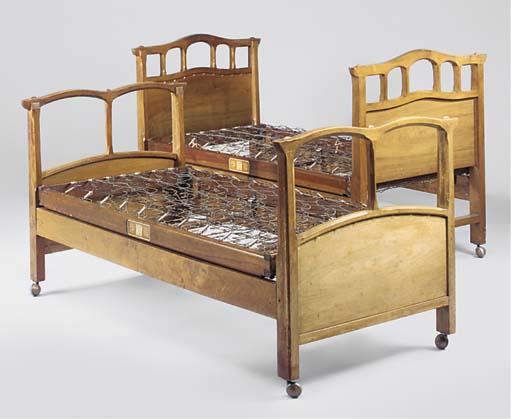 TWO WALNUT BEDS