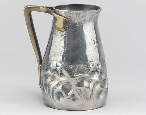 A Tudric Pewter and Brass Hand