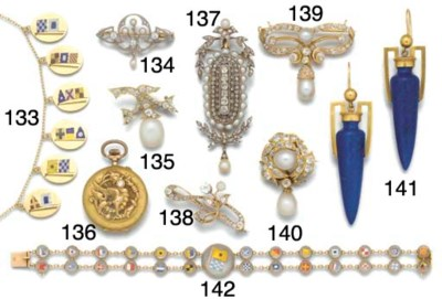 A diamond and pearl brooch wit