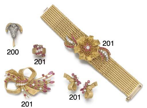 A diamond set rams head brooch