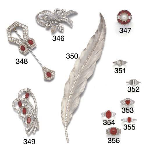 A diamond set feather brooch,