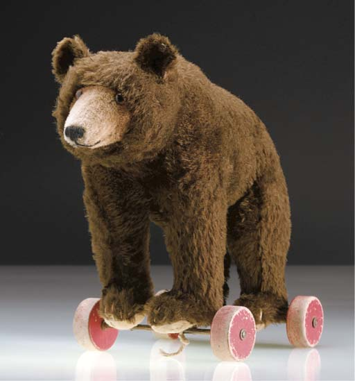 A Steiff bear on wheels