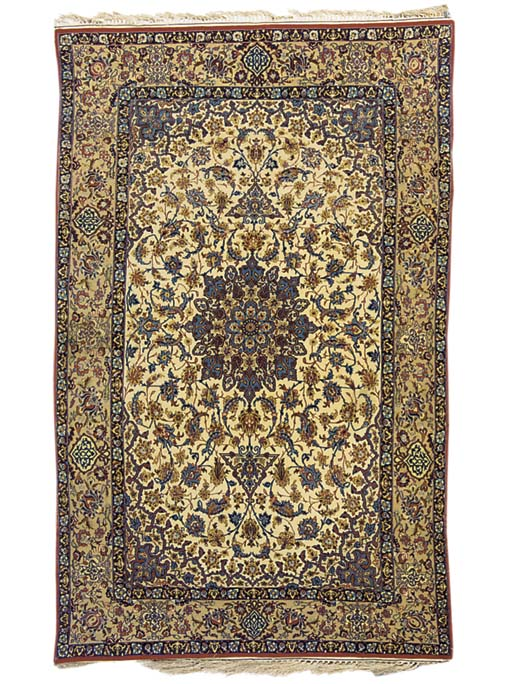 A pair of fine Isfahan rugs