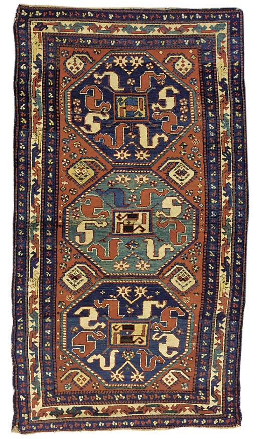 An antique Kazak Chonzorek rug