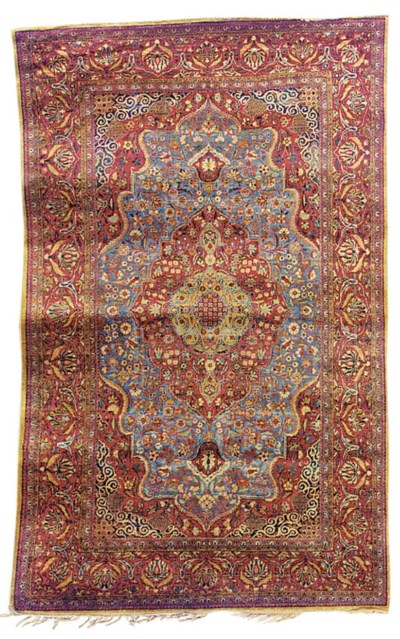 A fine silk Kashan rug