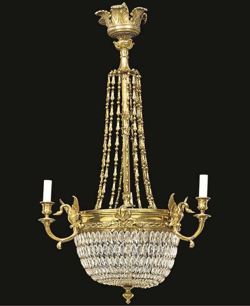A gilt metal and glass bead hu