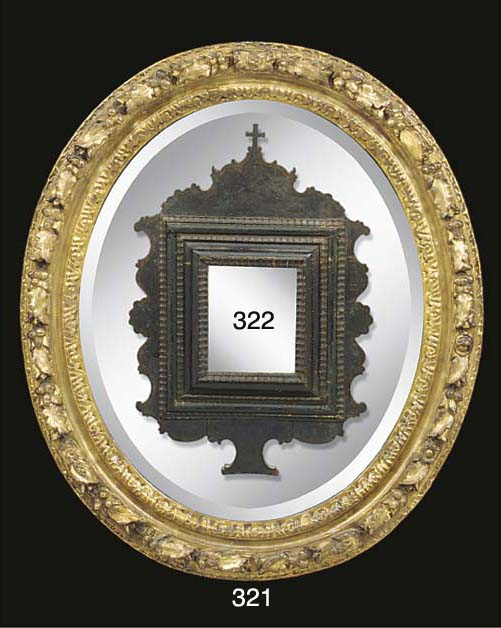 A Louis XIV carved and gilded oval frame