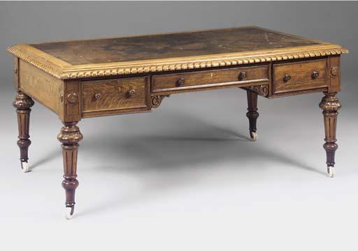 A large Victorian carved oak partners desk