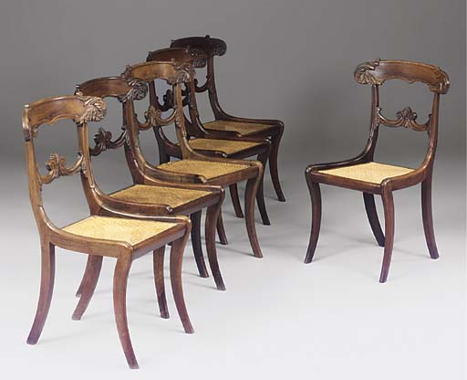 A SET OF SIX REGENCY CARVED ROSEWOOD DINING CHAIRS