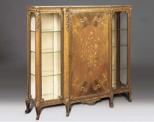A FRENCH ORMOLU MOUNTED KINGWOOD, ROSEWOOD AND MARQUETRY BREAKFRONT DISPLAY CABINET