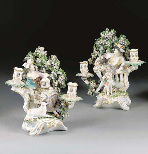 A pair of Chelsea figural two-