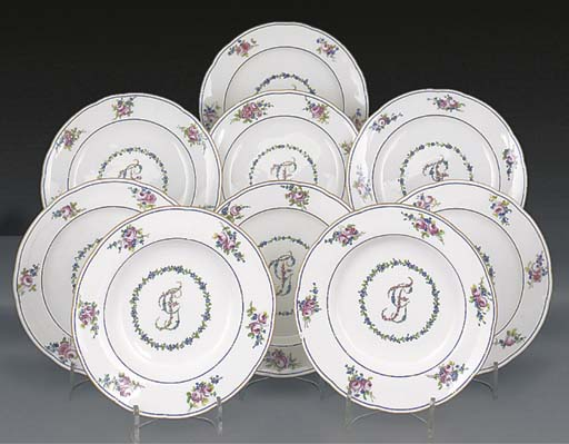 Seven Sevres plates and two so