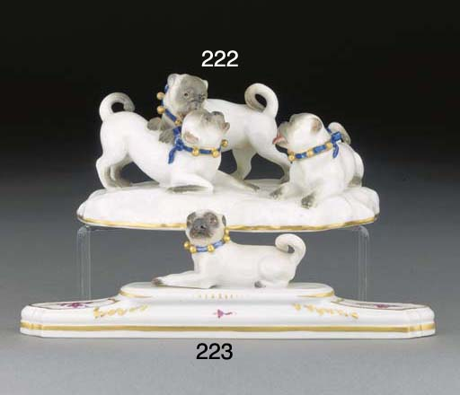 A Meissen group of three pugs