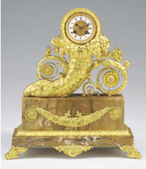 A French gilt-metal and Siena