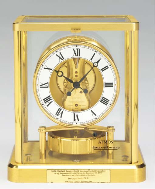 A Swiss brass Atmos timepiece,