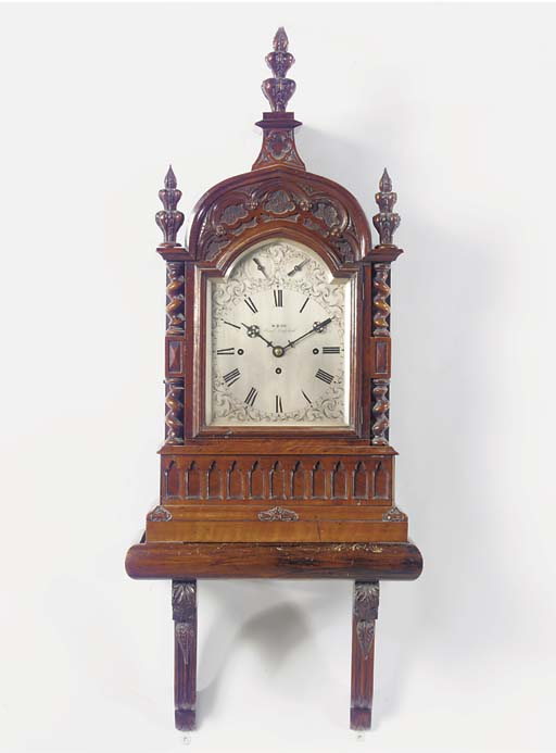 A Victorian carved rosewood qu