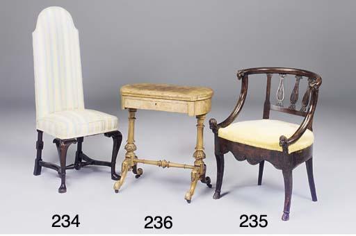 A walnut high back chair