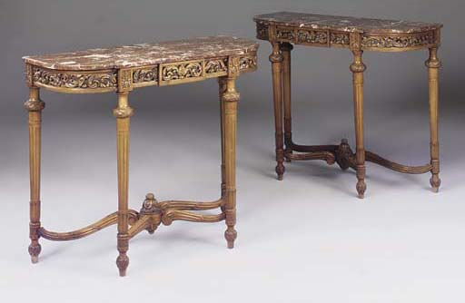 A pair of marble topped carved