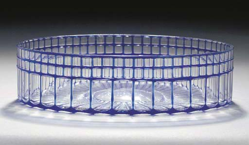 A BLUE AND CLEAR GLASS FACETED