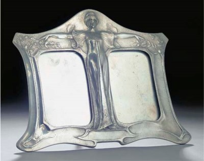 A PEWTER DOUBLE PICTURE FRAME