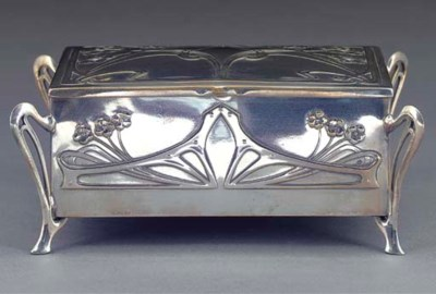 A SILVERED METAL BOX