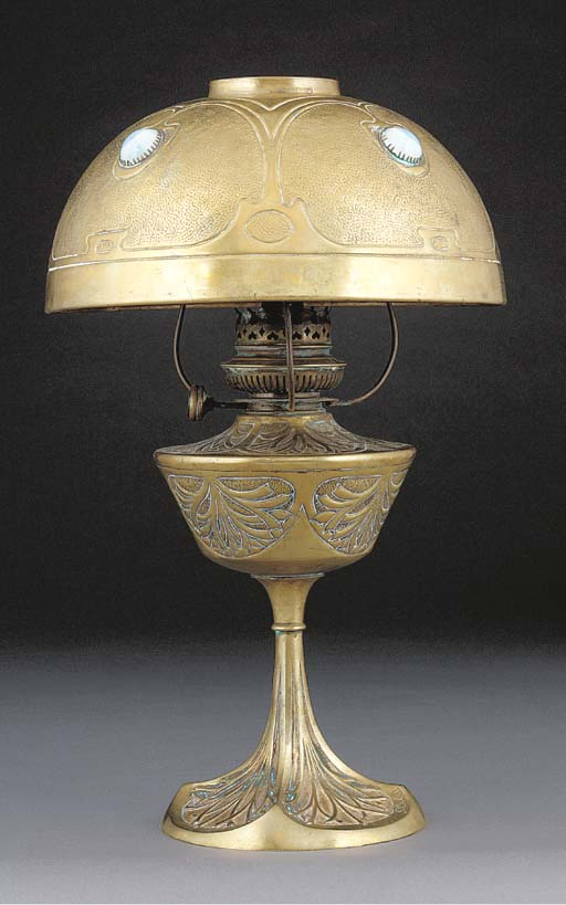 A BRONZE AND BRASS TABLE LAMP