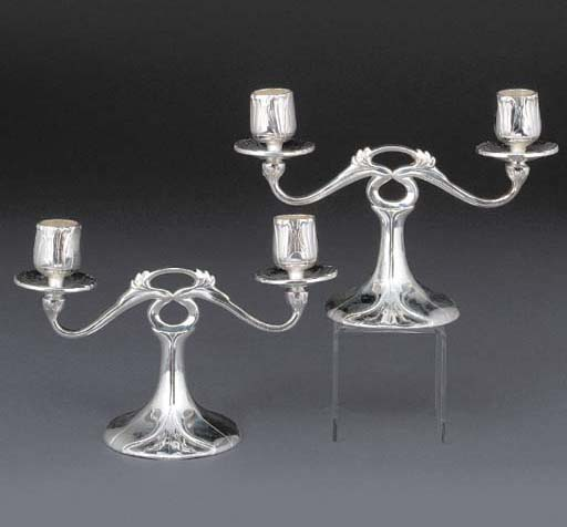 A PAIR OF DOUBLE-SCONCED SILVE