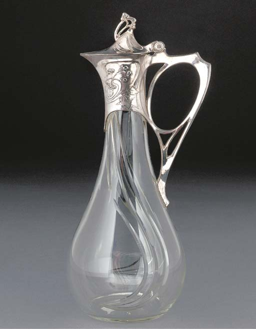 A SILVERED METAL AND GLASS DEC