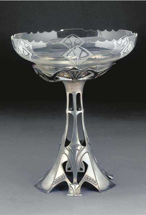 A SILVERED METAL AND GLASS CEN