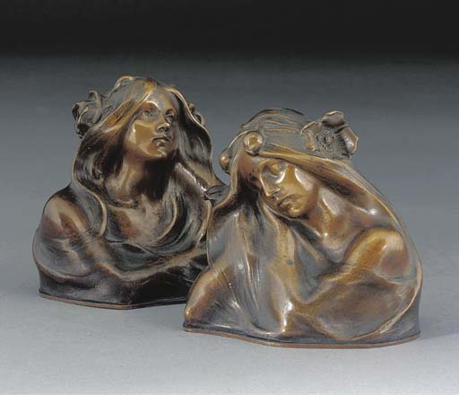 A PAIR OF PATINATED BRONZE BOO
